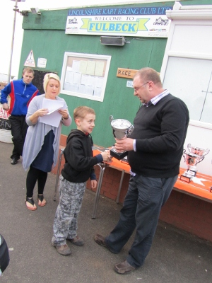 Ewan being presented with the Best Novice trophy at Fulbeck